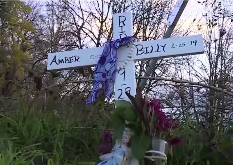 KOIN 6 NEWS - A marker at the scene where Billy Lewnes and Amber Coughtry were murdered on Sept. 29, 2020.
