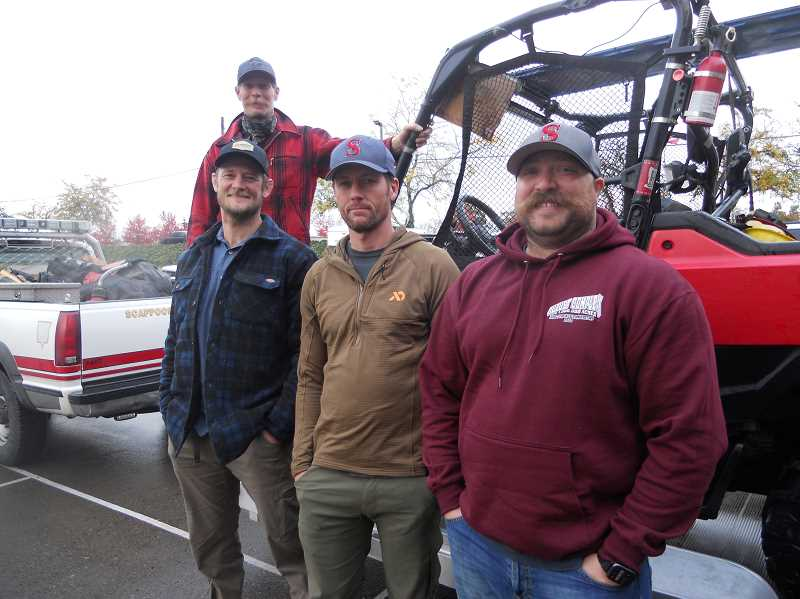 PMG PHOTO: SCOTT KEITH - Firefighters Garth Levin, Mike Maginn, Brian DuBois and Keith Mathews just returned from California fires