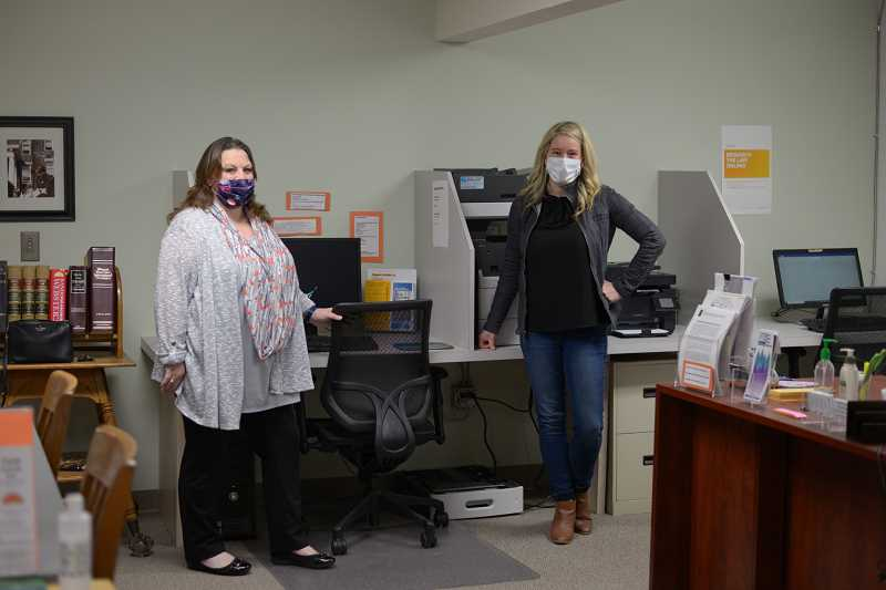 PMG PHOTO: ANNA DEL SAVIO - Janelle Adams, left, and Brandee Dudzic, right, run the Columbia County Law Library, providing residents with paperwork and guidance to represent themselves in legal proceedings like divorces or custody battles.
