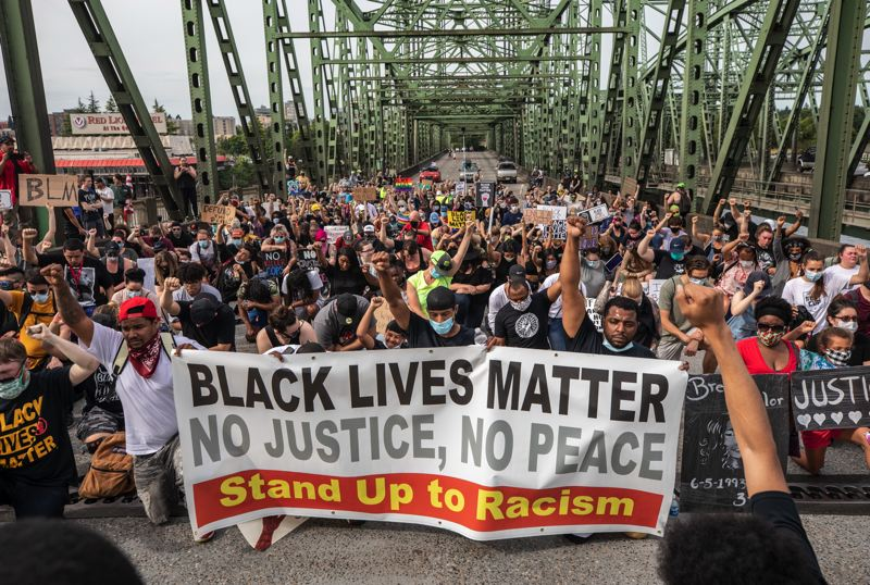 PMG PHOTO: JONATHAN HOUSE - Protesters marched toward Oregon on the Interstate Bridge to celebrate Juneteenth on Friday, June 19.
