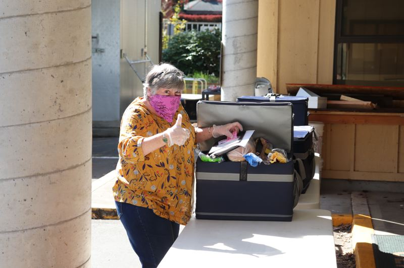 PHOTO COURTESY OF THE MILWAUKIE CENTER - A Milwaukie Center Meals on Wheels volunteer loads up to head out on a delivery run.