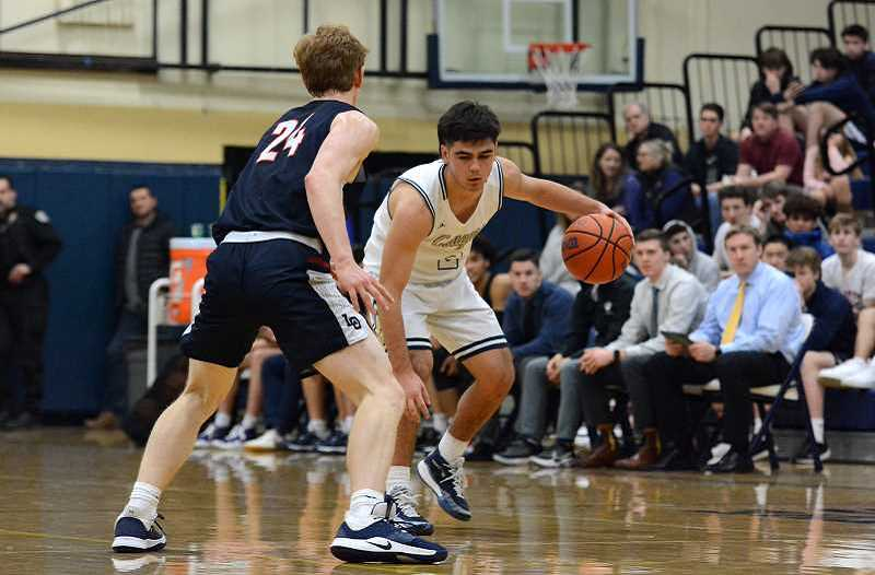 PMG FILE PHOTO: DEREK WILEY - Canby past senior Ronan Gay plays his last regular season home game for the Cougars on Feb. 26, 2020 against Lake Oswego.