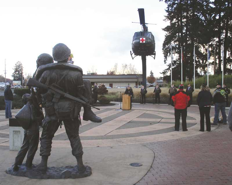 PMG PHOTO: DEBORAH GUINTHER - A small ceremony was held in Canby at the Vietnam Veterans Memorial on Nov. 11.