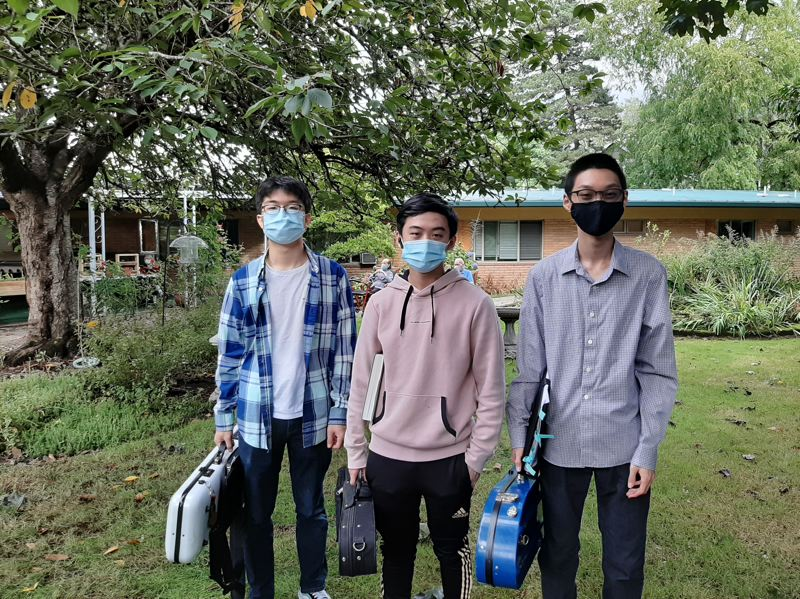 COURTESY PHOTO: IAN SONG - (From left) Jaewon Yune, Kalob Ho and Ian Song tote their insturments to a gig at a retirement center.