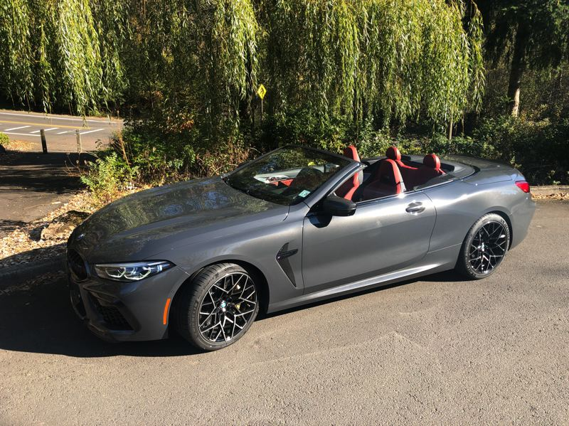 PMG PHOTO: JEFF ZURSCHMEIDE - The 2020 BMW M8 Competition Convertible is the modern equivalent of those patrician roadsters. This car is fast, comfortable, smooth, and expensive — and especially fun to drive with the top down.