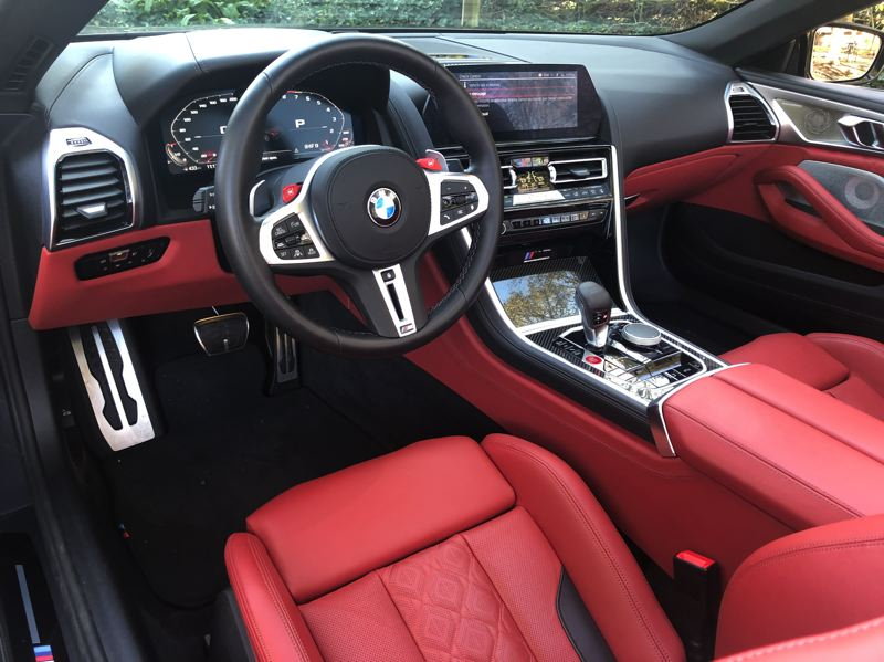 PMG PHOTO: JEFF ZURSCHMEIDE - The M8 Competition steering wheel is state-of-the-art sports car tech. It includes paddle shifters and red M1 and M2 buttons which can be programmed with various engine, suspension, steering, AWD, and braking system modes.