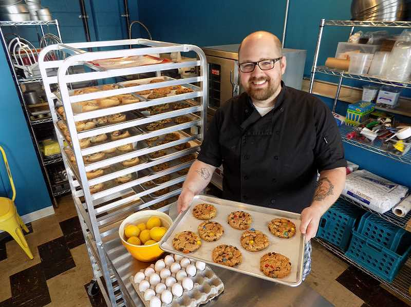 PMG FILE PHOTO - Alex Wilson displays a batch of cookies fresh out of the oven when he opened Hungry Hero in 2015. Since then, Wilson has tried to help out in the Sherwood community, expecially in times of need.