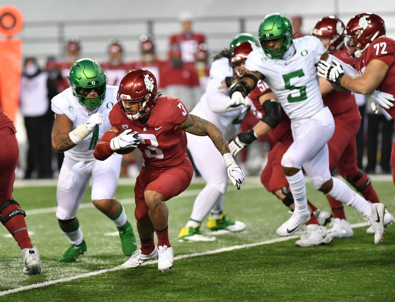 COURTESY PHOTO: BOB HUBNER/WSU PHOTOS - Noah Sewell (1), Kayvon Thibodeaux (5) and the Oregon defense made things difficult for Washinton State's Deon McIntosh and the Cougars in the second half of the Ducks 43-29 win.