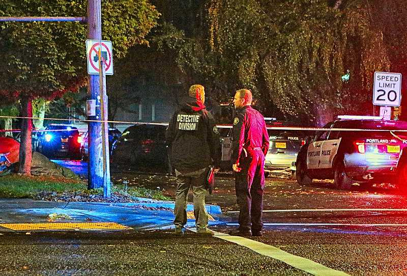 DAVID F. ASHTON - Officers cordoned off S.E. 33rd Avenue on November 7, on the east side of the CHS Athletic Field, to investigate a fatal shooting - which had apparently taken place in or near tents pitched beside the street.