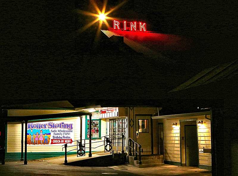 DAVID F. ASHTON  - The illuminated neon sign above, and the lit doorway of the historic Oaks Park Roller Skating Rink below, indicate that this beloved indoor attraction is again open for business - but only on a limited basis.