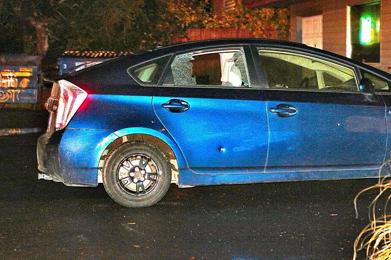 DAVID F. ASHTON - Fortunately, no one was inside this car when bullets shattered its window, and pock-marked its door