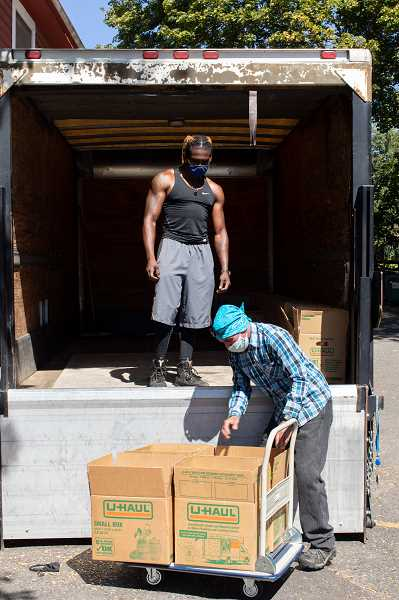 PHOTO COURTESY OF NEIGHBORHOOD HOUSE - Volunteers at Neighborhood House load up food boxes for delivery to households around Portland