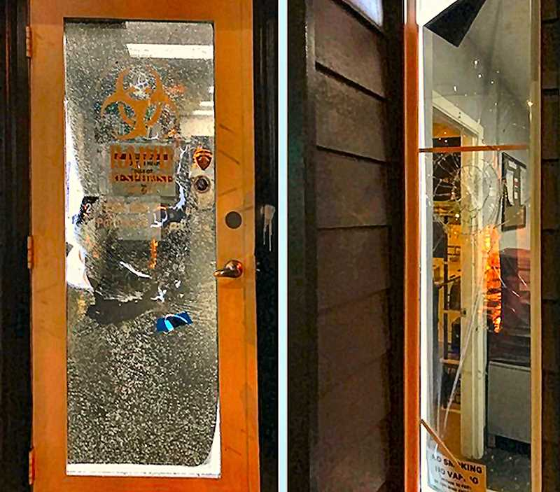 COURTESY PPB - Vandals posing as demonstrators attacked this Inner Southeast business, painting graffiti on the front of a building where a homeless camp clean-up service contracted to the city is located, and smashing a door (left) and windows (at right).