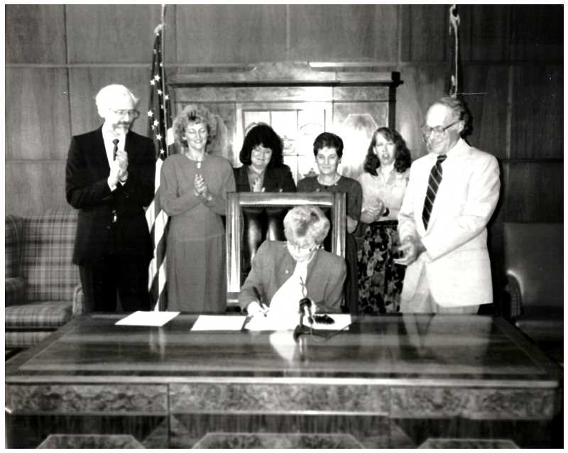 COURTESY PHOTO: DISABILITY RIGHTS OREGON - Bob Joondeph (left) looks on as Oregons Mandatory Abuse Reporting Bill is signed into law in 1991 by Gov. Barbara Roberts.