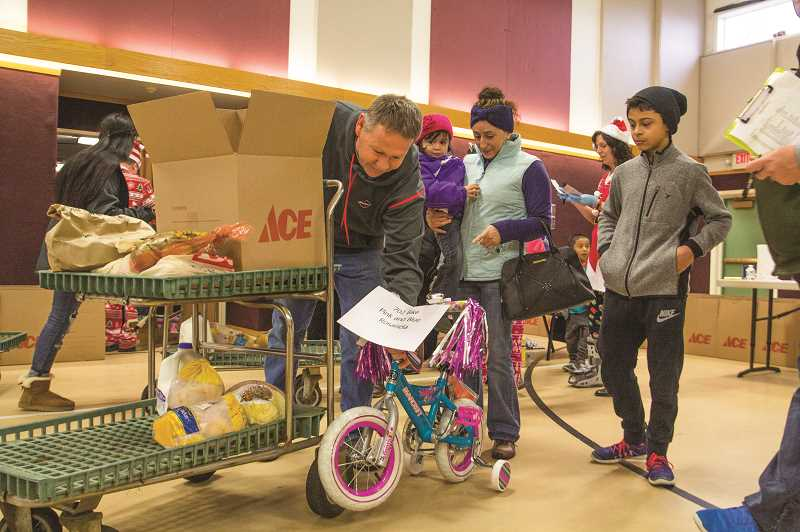 COURTESY PHOTO: LOVE SANTA - Gifts have always been a part of Love Santa, Inc., helping hand. But this year the Woodburn-area nonprofit will be focused on helping families with food.