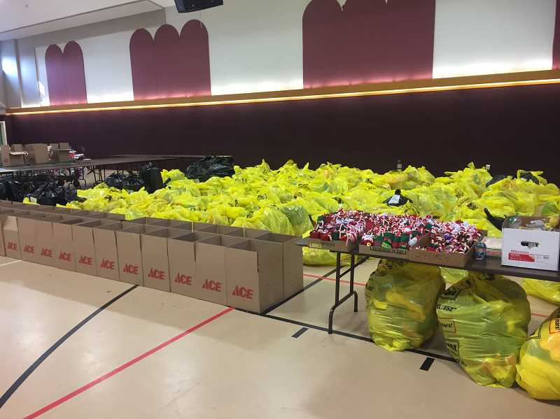 COURTESY PHOTO: LOVE SANTA - Supplies mount and boxes are ready as Woodburn-area nonprofit Love Santa, Inc., gets ready to furnish up to 450 families with food boxes this year.