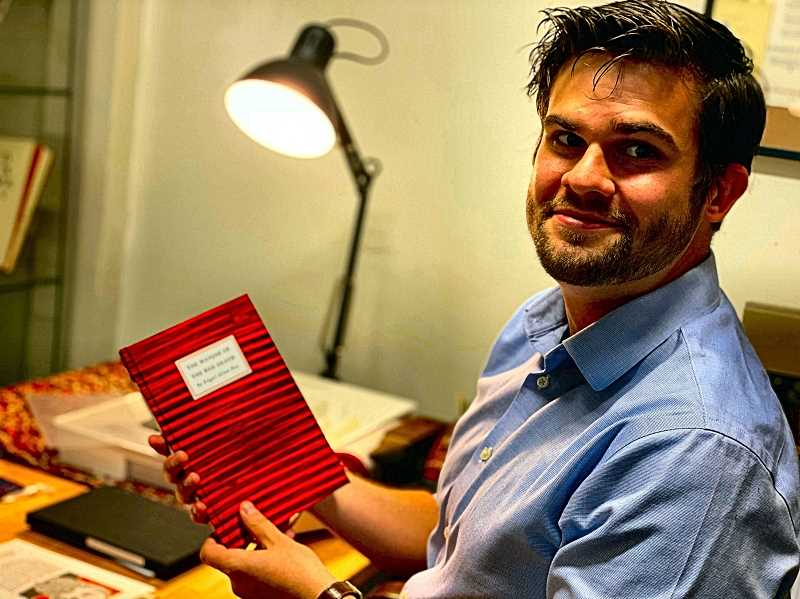 PAIGE WALLACE - Editor Griffin Gonzales shows off one of the No Reply Press hand-made collectible books, made at the companys small production studio in Ladds Addition, just north of Brooklyn.