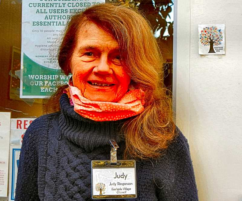 ELIZABETH USSHER GROFF - At the door of the Eastside Village office at Trinity United Methodist Church on Steele Street is Judy Ringenson - a member of the EV Climate Crisis Crew. She has also been on the Eastside Village Council since the nonprofits inception, five years ago.