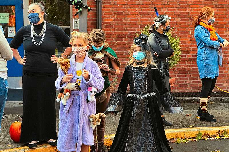 DAVID F. ASHTON - Adults and kids got to show off their Halloween costumes at this safely-distanced, drive-by Holy Family School after-school celebration.