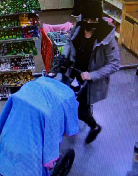 COURTESY PHOTO: - A woman suspected of a strong-arm robbery at a farm and ranch store in Cornelius is seen on a security camera.