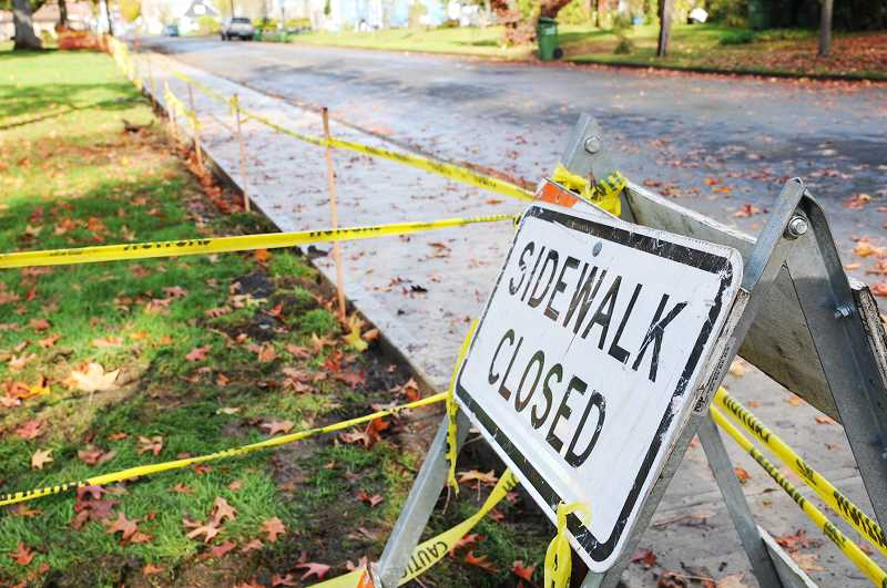 PMG PHOTO: GARY ALLEN - Memorial Park will be surrounded on three sides by sidewalks for the first time thanks to an ongoing project by the city.