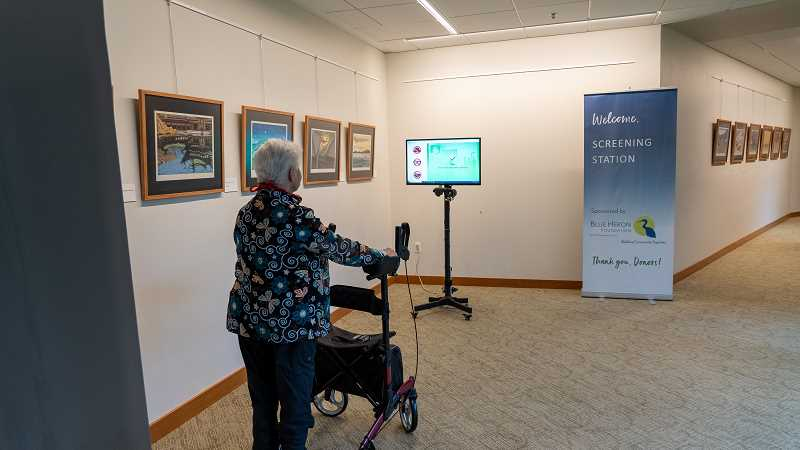 COURTESY PHOTO - Lynda La Raus, a Willamette View resident, gets her temperature screened by FLIR's thermal imaging technology.
