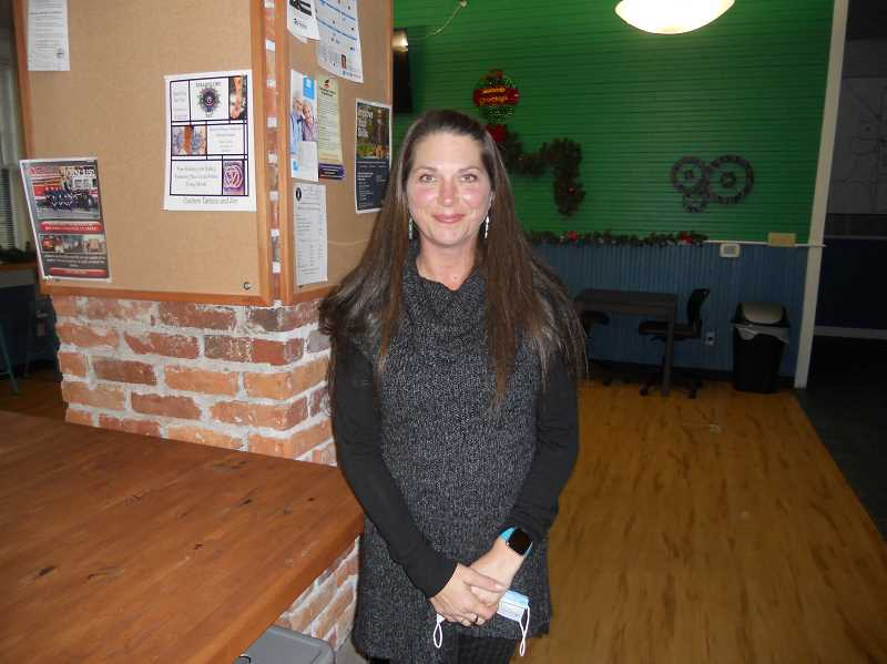 PMG PHOTO: SCOTT KEITH - Heather Karrick assists visitors at the South Columbia County Chamber of Commerce