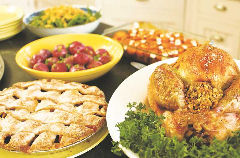 PMG FILE PHOTO - A local catering company is joining forces with the NDPD in delivering turkey dinners to seniors in the area.