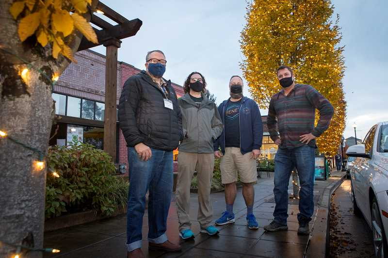 PMG PHOTO: JAIME VALDEZ - Illuminating 13 of Tigards Main Street trees is thanks to the efforts of, from left, Travis Diskin of Curiosities Vintage Mall, Chris Sjolin, co-owner of Cooper Mountain Ale Works; Derrick Wright of Senet Game Bar and Chris Haedinger of Beach Hut Deli.