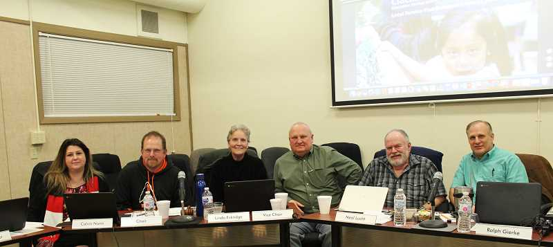 KRISTEN WOHLERS - Molalla's school board members are from left to right: Jennifer Satter, Chair Calvin Nunn, Vice Chair Linda Eskridge, Neal Lucht, Ralph Gierke and Craig Loughridge. Not Pictured: Mark Lucht