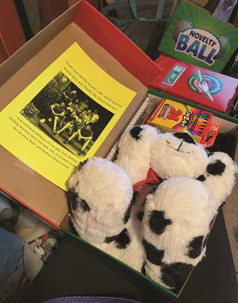 COURTESY PHOTO: SUSAN BUCK - Each shoebox contains a 'wow' toy, school supplies and hygiene items. Givers are encouraged to add a personal note.