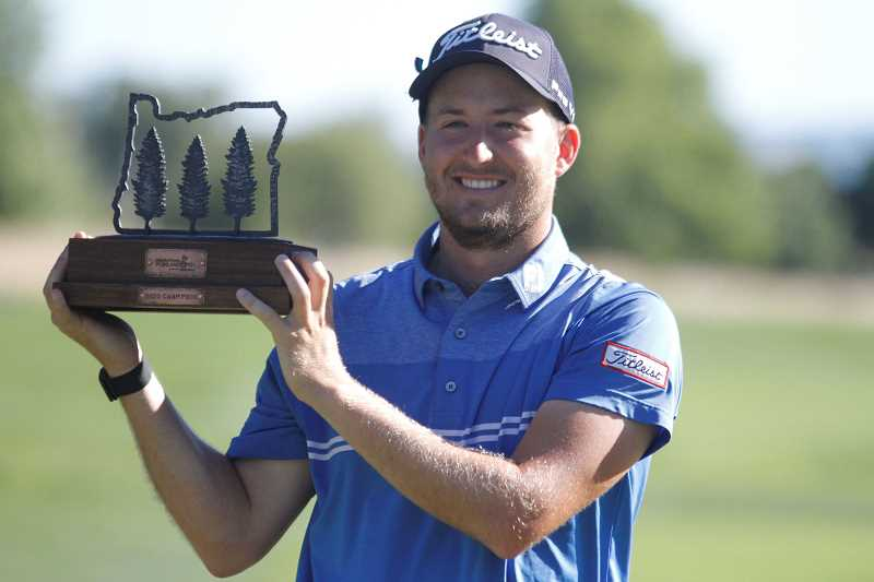 PMG PHOTO: WADE EVANSON - Lee Hodges poses for a photo with the trophy following the final round of the Winco Foods Portland Open Sunday, Aug. 9, at Pumpkin Ridge Golf Club in North Plains., Portland Tribune - Sports The Alabama native shoots a final round 71, two shots clear of four second place finishers. Lee Hodges notches first Korn Ferry Tour win at Winco Foods Portland Open