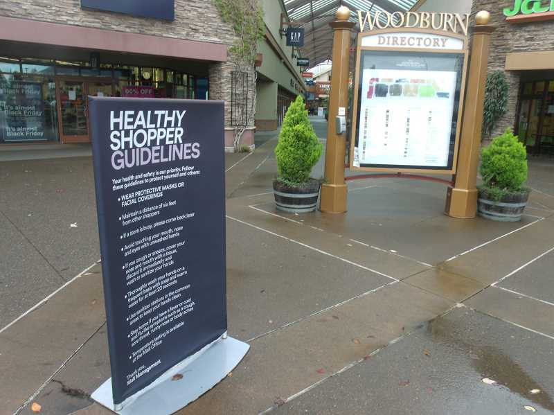 PMG PHOTO: JUSTIN MUCH - Healthy Shopper Guidelines are posted at every entry to Woodburn Premier Outlets, along with hand sanitizer.