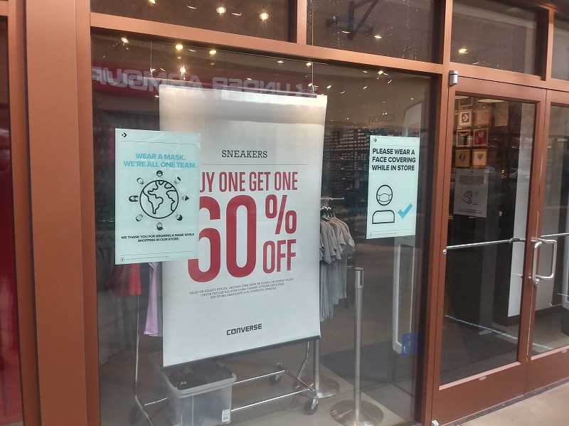 PMG PHOTO: JUSTIN MUCH - While Woodburn Premium Outlets have a guidlines posted at every entrance to urge shoppers to be pandemic wise, some stores also posted their own signs.