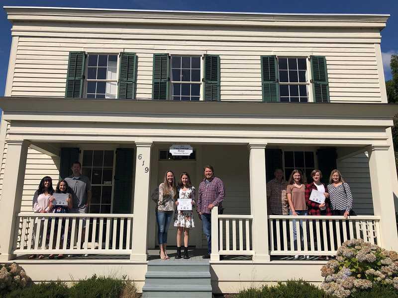 COURTESY PHOTO - Poetry winners in Preserve Our Past contest join their families at the historic Ermatinger House this summer.