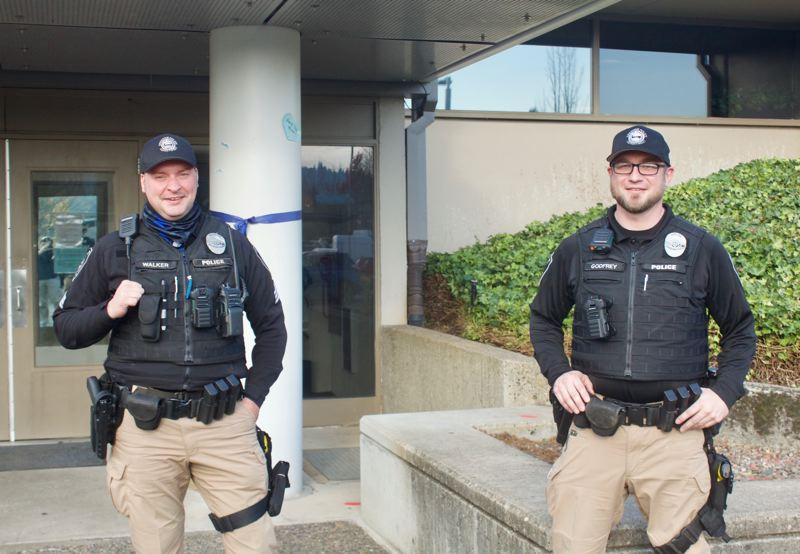 PMG PHOTO: CHRISTOPHER KEIZUR - Gresham Police Sgt. Tommy Walker and Officer Ralph Godfrey are two of the three uniformed members who make up the Gresham Service Coordination Team.