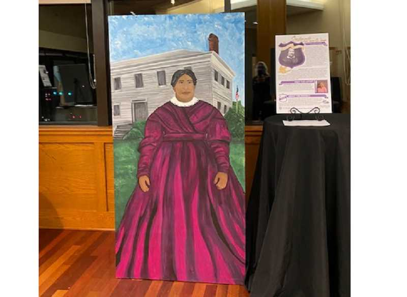 COURTESY PHOTO: TRIESTE ANDREWS - Marguerite McLoughlin is currently depicted as part of a 19th Amendment celebration at the Holmes House.