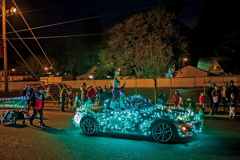 PMG FILE PHOTO - A car bedazzled with lights participates in the Jingle Thru North Plains community parade. The tradition of a lighted holiday parade is spreading this year to Tualatin.