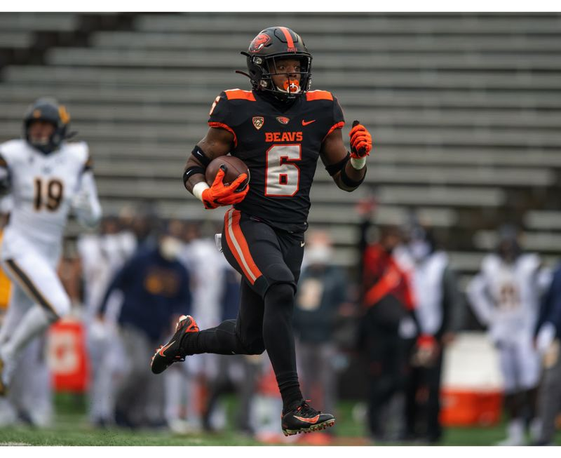 COURTESY PHOTO: KARL MAASDAM/OSU ATHLETICS - Jermar Jefferson opened the game with a 75-yard TD run (above) and helped finish it with a 65-yard run as Oregon State beat California 31-27.