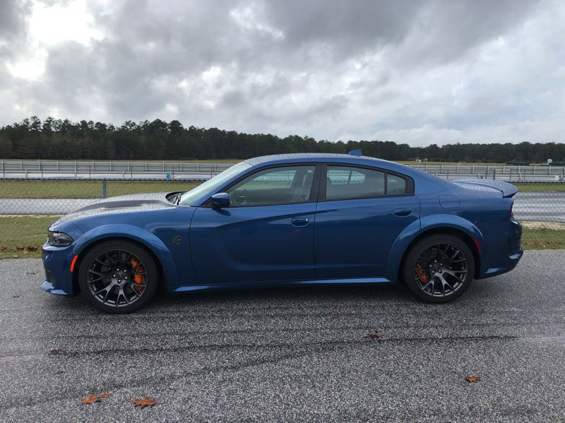PMG PHOTO: JEFF ZURSCHMEIDE - The Charger SRT Hellcat Redeye is also a great looking car. The widebody kit and deep, wide wheels give this machine a bold, aggressive stance.