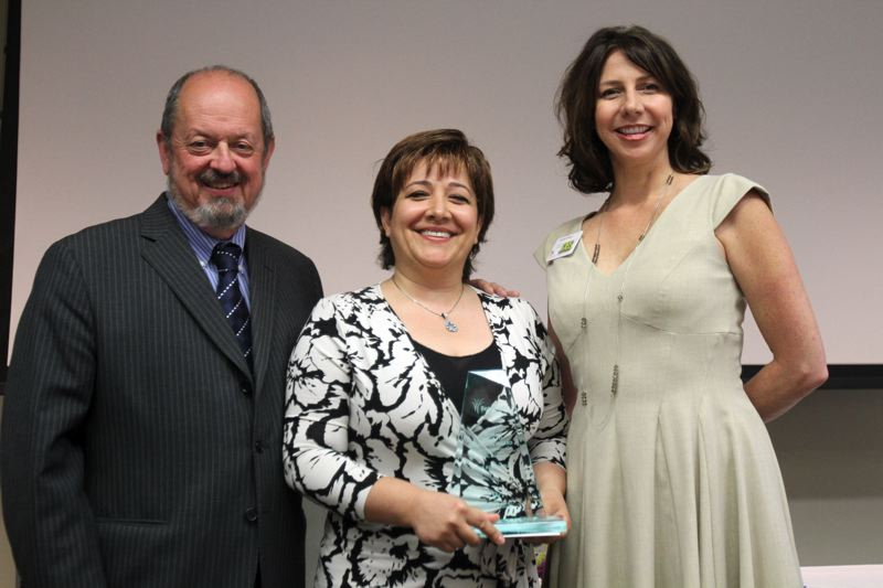 PMG FILE PHOTO: JONATHAN HOUSE - Ava Roasteria's Amy Saberiyan, center, received an award for Business of the Year during the 2012 Service to Beaverton Awards.