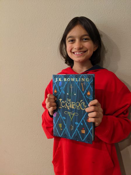 COURTESY PHOTO: SCHOLASTIC CORPORATION - Kinza Arik, 9, holding her copy of 'The Ickabog,' a new book by J.K. Rowling that features a drawing by Arik.
