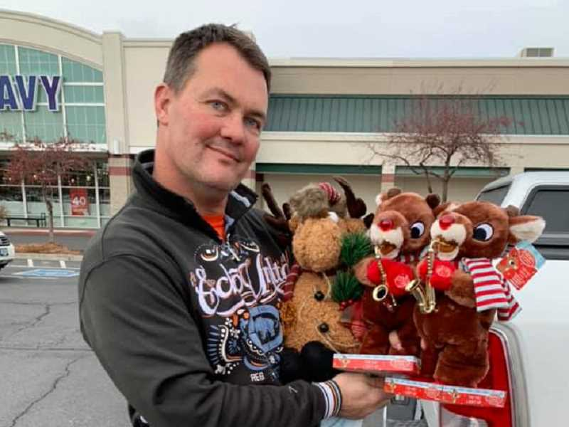 PHOTO COURTESY OF FANNY HOLLINGSHEAD - Madras Les Schwab Tire Center Manager Ron Hollingshead shows the three Rudolph toys that he will place along the Madras Trails Thanksgiving morning for Race for Rudolph participants to find.