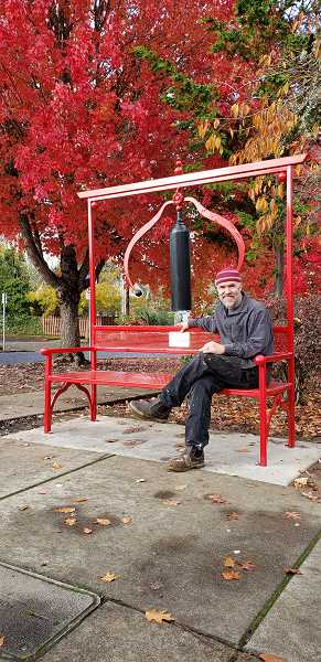 COURTESY PHOTO: TUALATIN VALLEY CREATES - Jud Turner sits on his Wishing Bench in downtown Forest Grove, on the corner of A Street and 21st Avenue.