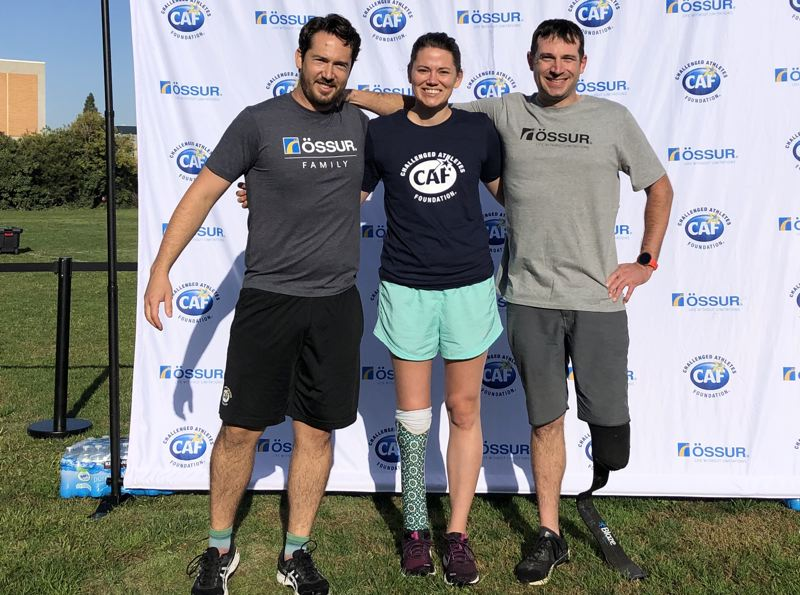 COURTESY PHOTO: KIMMIE CHAMPION - Kimmie Champion, at the 2019 Challenged Athletes Foundation Triathlon with with fellow certified orthotist/prosthetist Ben Clark (left) and friend Dan Marsh (right).