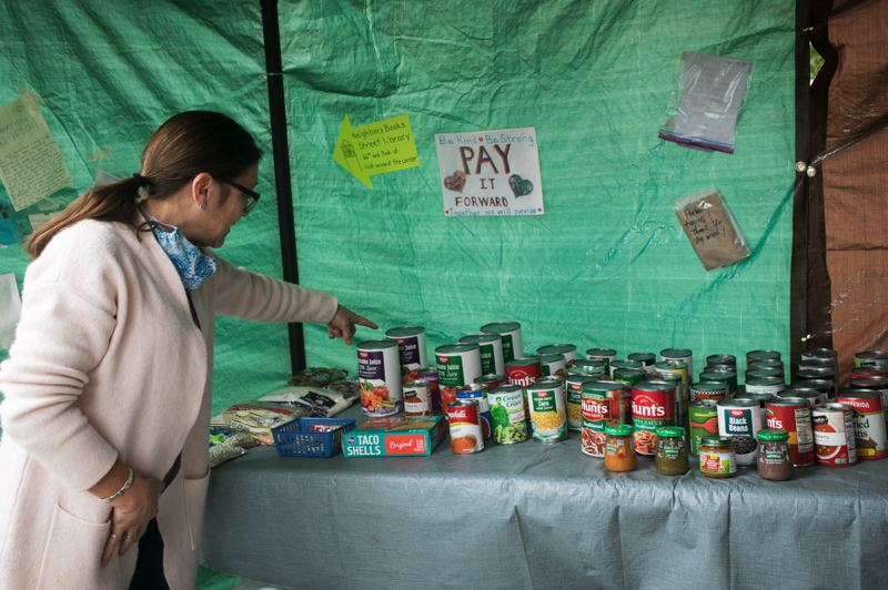 PMG PHOTO: JAIME VALDEZ - Ramona Peterson shows what is offered at her food pantry. On many days, she can be found inside cooking homemade soup to distribute to those who need it.