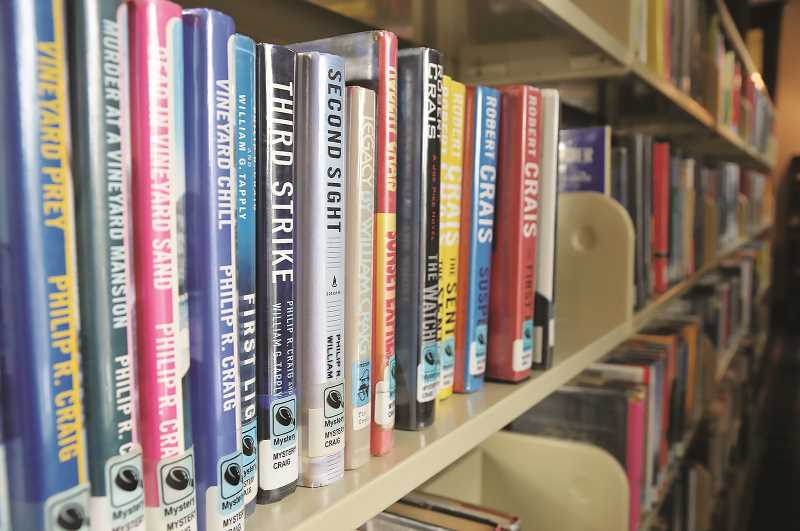 PMG FILE PHOTO - The Newberg Public Library has initiated a new program that allows patrons to request a bundle of books by a particular genre or topic, then receiving the tomes chosen by staff for curbside pickup.