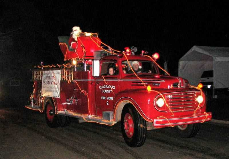 PHOTO COURTESY: CLACKAMAS FIRE - In past years, Santa appeared in a neighborhood parades hosted by Clackamas Fire, but those parades have been canceled for 2020.