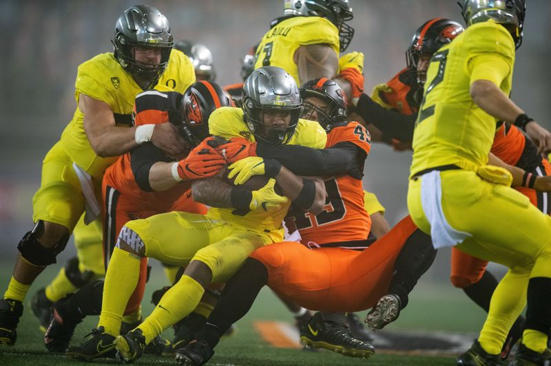 COURTESY PHOTO: KARL MAASDAM/OSU ATHLETICS - The Oregon State defense held Oregon to two second-half touchdowns in the Beavers' 41-38 win Friday.