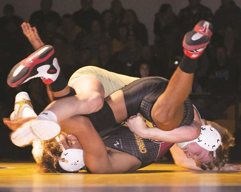 CENTRAL OREGONIAN - With COVID regulations, contact sports may not happen this winter. Even if Crook County is allowed to have contact sports like wrestling and basketball, Deschutes and Jefferson counties, with higher COVID statistics, may not, leaving Crook County with no regional opponents to face. Above, Brayden Duke, top, wrestles a Crescent Valley opponent last winter.